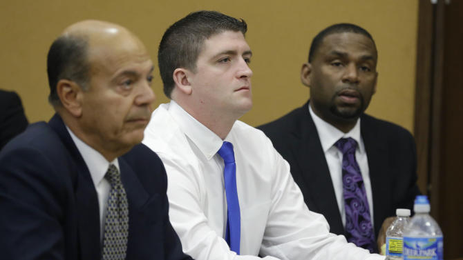 Cleveland police Officer Michael Brelo, center, listens with his attorneys to opening arguments in court, Monday, April 6, 2015, in Cleveland. Brelo, 31, went on trial Monday on two counts of voluntary manslaughter in the November 2012 deaths of Timothy Russell, 43, and Malissa Williams, 30, after a high-speed chase. (AP Photo/Tony Dejak, Pool)