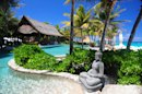 A statue decorates the pool area of Richard Branson's property on Necker Island in the British Virgin Islands, Friday, May 17, 2013. Political and business leaders gathered here Friday to back an initiative aimed at expanding protection for the Caribbean's imperiled coasts and waters. Delegations from the participating governments signed a communique pledging to establish a framework for a regional approach to coastal conservation, including increasing considerably the number of marine protected areas. They also said they recognized an urgent need to protect sharks and rays, and vowed a dramatic acceleration in the transition from fossil fuels to alternative energy sources over the next five years. (AP Photo/Todd VanSickle)