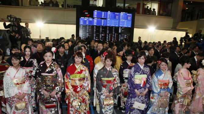Kimono-clad workers attend traditional New Year's opening ceremony at the Tokyo Stock Exchange in Tokyo Friday, Jan. 4, 2013. (AP Photo/Koji Sasahara)