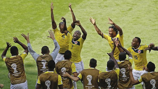 Colombia's Pablo Armero (7) dances with teammates in celebration after scoring during the group C World Cup soccer match between Colombia and Greece at the Mineirao Stadium in Belo Horizonte, Brazil, Saturday, June 14, 2014