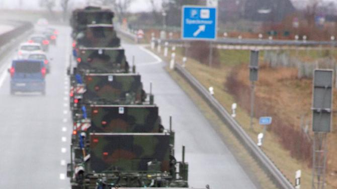 Army trucks  drive on highway A20 near Vietow , eastern Germany  on their way to Luebeck-Travemuende harbour, Sunday Jan. 6, 2013. Patriot missile batteries were being prepared for shipment from Germany to Turkey on Sunday as part of efforts meant to protect the NATO (North Atlantic Treaty Organisation) ally from potential Syrian warheads.The US, Germany and the Netherlands are each deploying two batteries of the US-built defence system to boost Turkey's air defences against any spillover from Syria's nearly two-year civil war.  (AP Photo/dapd/Jens Koehler)
