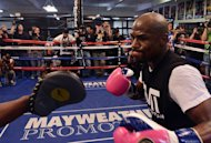 Boxer Floyd Mayweather works out at the Mayweather Boxing Club on April 17, 2013 in Las Vegas, Nevada. Mayweather says neither jail time nor ring rust from a one-year layoff will diminish him next week when he returns against compatriot Robert Guerrero