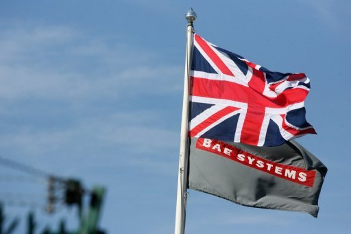 <p>The Union Jack is seen flying alongside the BAE flag at the BAE Systems site at Brough in East Yorkshire, north east England, in 2011. British arms maker maintained its profit outlook for the year, a day after announcing the collapse of a proposed mega-merger with European aerospace giant EADS.</p>