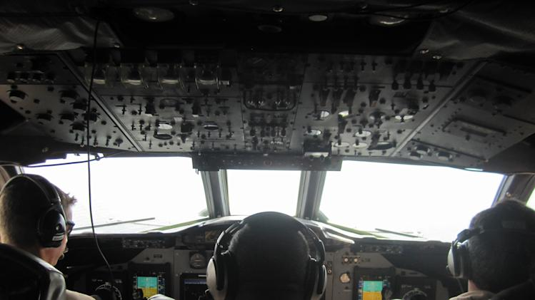 In this Jan. 25, 2013 photo, U.S. Customs and Border Protection pilots navigate a P3 Orion Airborne Early Warning Aircraft while flying over waters near the Pacific coast of Costa Rica. The Central American country abolished its army in 1948 and plowed money into education, social benefits and environmental preservation. As a result, Costa Rican officials say, the country can't battle ruthless and well-equipped Mexican drug cartels without U.S. help. The U.S. is patrolling Costa Rica's skies and waters and providing millions of dollars in training and equipment to Costa Rican officials who have launched a tough line on crime backed by top-to-bottom transformation of the law-enforcement and justice systems. (AP Photo/Michael Weissenstein)