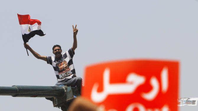 "An opponent of Egypt's Islamist President Mohammed Morsi shouts slogans during a protest in Tahrir Square in Cairo, Egypt, Wednesday, July 3, 2013. A Defense Ministry official said army chief Gen. Abdel-Fattah el-Sissi is meeting with his top commanders, hours before the military's deadline to the president and opposition to resolve the nation's political crisis is set to expire. Arabic read "" leave."" (AP Photo/Amr Nabil)"
