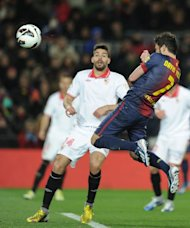 Barcelona's forward David Villa scores during their Spanish league football match against Sevila at the Camp Nou stadium in Barcelona on February 23, 2013. Barcelona won 2-1