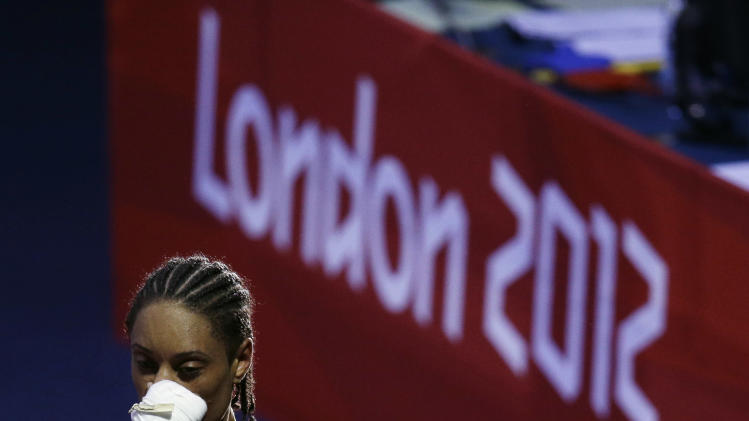 Quanitta Underwood of the United States, leaves the arena after her fight against Natasha Jonas of Great Britain, during the women's lightweight boxing competition at the 2012 Summer Olympics, Sunday, Aug. 5, 2012, in London. (AP Photo/Patrick Semansky)