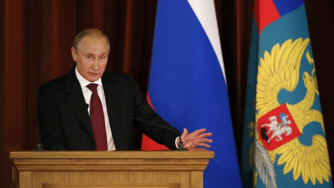 Russian President Vladimir Putin speaks at a meeting with Russian ambassadors, envoys and diplomats at the Foreign Ministry headquarters in Moscow, Tuesday, July 1, 2014. (AP Photo//Maxim Zmeyev, Pool)