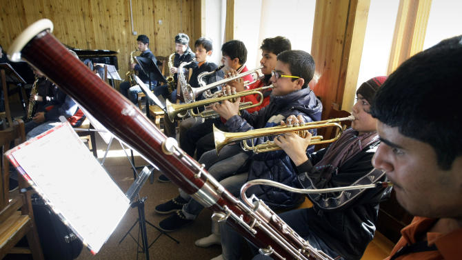 In this Monday,  Jan. 7, 2013 photo, Afghan students practice playing the bassoon and the trumpets in a class at the Afghanistan National Institute of Music in Kabul, Afghanistan. Dozens of Afghan teenagers including former street kids or orphans aged 10 to 22, will be playing in the Afghan Youth Orchestra which begins a 12-day U.S. tour on Feb. 3 and includes concerts at Washington's Kennedy Center - President Barrack Obama has been invited - New York's Carnegie Hall and the New England Conservatory in Boston. (AP Photo/Musadeq Sadeq)