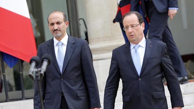 France's president Francois Hollande, right, accompanies Syria National Coallition president Ahmed al-Jarba after their meeting at the Elysee Palace in Paris, France, Wednesday, July 24, 2013. (AP Photo/Francois Mori)