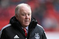 Craig Brown was pleased Aberdeen overcame a tortuous journey to collect a point on Saturday