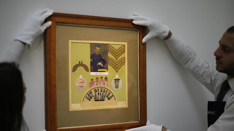 "FILE This Friday, Nov.  9, 2012 file photo shows employees from Sotheby's auction house adjust the original Sir Peter Blake 1967 collage for the iconic Beatles album Sgt Pepper's Lonely Hearts Club Band, which will be sold at  auction, during a press viewing in London. Sotheby's says an original piece of artwork from the Beatles' ""Sgt Pepper's Lonely Hearts Club Band"" album has fetched 55,250 pounds ($87,720) at auction. The auction house said the original 1967 collage for the insert to the album sold to a bidder in London on Tuesday Nov.13, 2012. The sale marked the first time the collage by Sir Peter Blake was on the market.  The auction house said Blake was introduced to the Beatles by his dealer, and that he and his wife worked closely with Paul McCartney and John Lennon to create the imagery of the Sgt. Pepper.  (AP Photo/Alastair Grant, file)"
