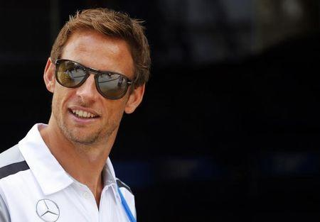 McLaren Formula One driver Button of Britain arrives at the Hungaroring circuit, near Budapest