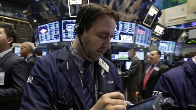 Trader Michael Mozian works on the floor of the New York Stock Exchange Tuesday, March 25, 2014. Stocks are opening higher on Wall Street as the market shrugs off a two-day decline. (AP Photo/Richard Drew)