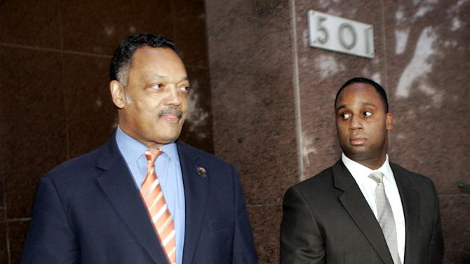 FILE - In this Jan. 19, 2006 The Rev. Jesse Jackson, left, and his son Jonathan leave Los Angeles Superior Court. At 71, Jackson Sr. still keeps a hectic schedule and speaks extemporaneously on civil rights issues of all kinds. But he struggles when addressing one thing: Jesse Jackson Jr., the son and heir to Jackson's political influence who abandoned his congressional seat last week because of mental health problems and two federal investigations. Jonathan Jackson, a Chicago State University business professor, is contemplating seeking the congressional seat vacated by Jesse Jr. (AP Photo/Ric Francis, File)
