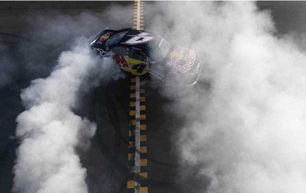 Kasey Kahne does a burnout at the finish line after winning the NASCAR Sprint Cup Series auto race at Phoenix International Raceway, Sunday, Nov. 13, 2011, in Avondale, Ariz. (AP Photo/Jonathan Ferrey