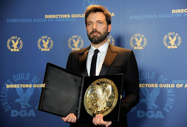 Ben Affleck poses backstage with his award for outstanding directorial achievement in feature film for &quot;Argo&quot; at the 65th Annual Directors Guild of America Awards at the Ray Dolby Ballroom on Saturday, Feb. 2, 2013, in Los Angeles. (Photo by Chris Pizzello/Invision/AP)