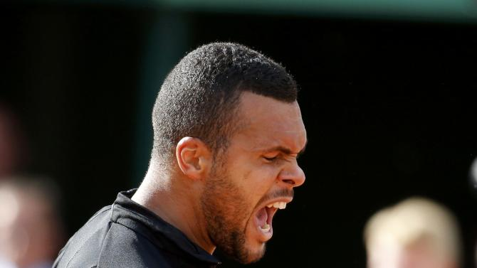 Jo-Wilfried Tsonga of France reacts during his men's quarter-final match against Kei Nishikori of Japan during the French Open tennis tournament at the Roland Garros stadium in Paris