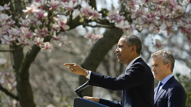 President Barack Obama, accompanied by acting Budget Director Jeffrey Zients, speaks in the Rose Garden of the White House in Washington, Wednesday April 10, 2013, to discuss his proposes fiscal 2014 federal budget. (AP Photo/J. David Ake)