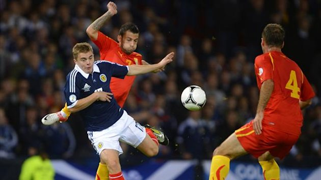 Macedonia's Ivan Trichkovski challenges Scotland's James Forrest (L) during their 2014 World Cup qualifier (Reuters)