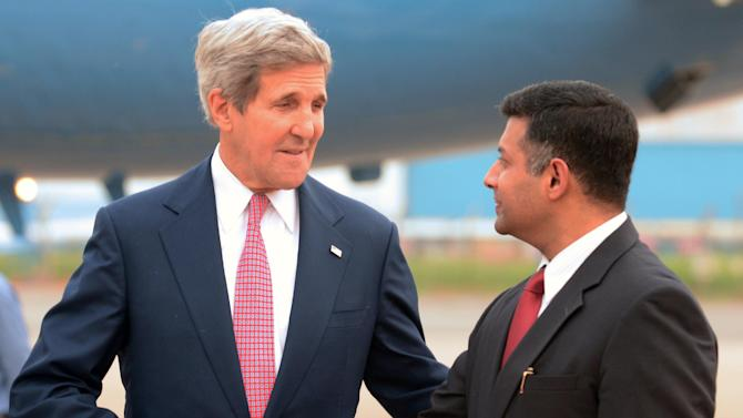 US Secretary of State John Kerry shakes hands with Indian Ministry of External Affairs Joint Secretary Vikram Kumar Doraiswami upon his arrival at Palam Air Base in New Delhi on July 30, 2014