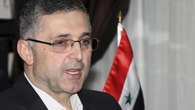 Ali Haider, the Syrian Minister for Reconciliation Affairs, speaks during an interview with The Associated Press in Damascus, Syria on Sept. 11, 2013. Cabinet minister Ali Haidar said Syria's acceptance of a Russian initiative to relinquish its chemical weapons is a sign of strength and that by agreeing to the proposal, Syria has taken away one of the pretexts for war against Syria although he says the threat of foreign military action remains. (AP Photo)