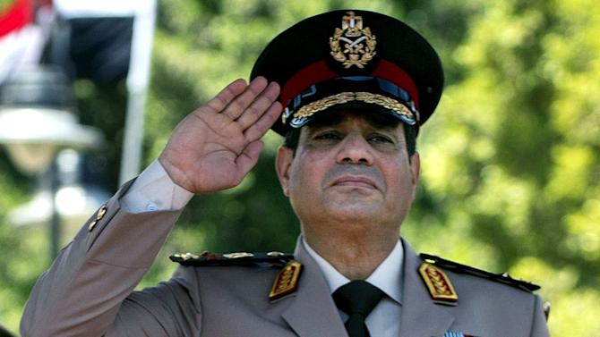 FILE - In this Wednesday, April 24, 2013 file photo, Gen. Abdel-Fattah el-Sissi of Egypt's Defense Minister salutes during an arrival ceremony for U.S. Secretary of Defense Chuck Hagel at the Ministry of Defense in Cairo, Egypt. On Saturday, March, 8, 2014 interim Egyptian President Adly Mansour issued a law regulating the upcoming election, which is expected to be held by the end of April. As he nears announcing a run for Egypt's presidency, El-Sissi has been focusing on preparing an economic program, senior generals and government officials say, demonstrating the wariness within the military over the scale of problems facing the country. (AP Photo/Jim Watson, Pool, File)