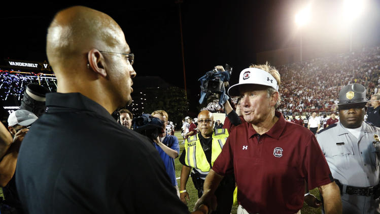 South Carolina head coach Steve Spurrier, right, shakes hands with Vanderbilt head coach James Franklin following their NCAA college football game, Thursday, Aug. 30, 2012, in Nashville, Tenn. South Carolina won 17-13. (AP Photo/John Russell)