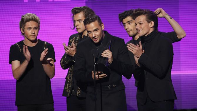 One Direction accept the award for artist of the year during the 42nd American Music Awards in Los Angeles