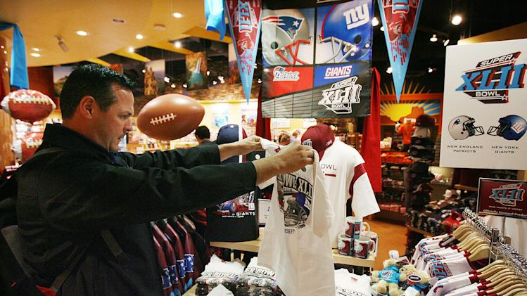 In this Jan. 29, 2008 file photo, Mike San Miguel, of La Verne, Calif., checks out the Super Bowl merchandise in the Arizona Highways retail store at Phoenix Sky Harbor International Airport before catching a flight. Broadway producers, merchants and restaurateurs may not see the profits they hope will come with the Super Bowl visiting New York as fans will more likely spend their money on NFL branded merchandise and events. (AP Photo/Ross D. Franklin, File)