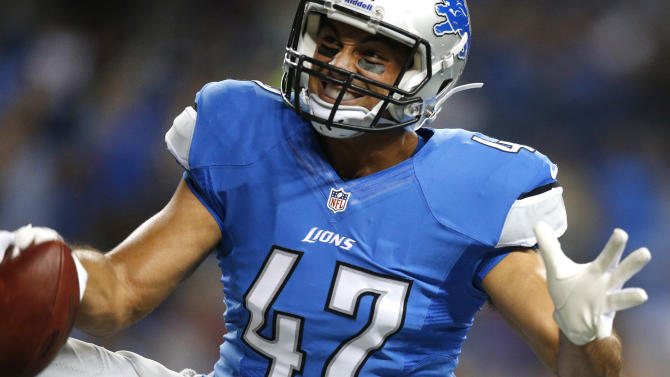 Detroit Lions tight end Joseph Fauria celebrates his 22-yard touchdown reception against the New England Patriots in the third quarter of an NFL preseason football game in Detroit, Thursday, Aug. 22, 2013. (AP Photo/Rick Osentoski)
