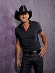 "This Jan. 15, 2013 photo shows country singer and actor Tim McGraw in Nashville, Tenn. His latest album, ""Two Lanes of Freedom,"" was released on Tuesday, Feb. 5. The Tennessee Supreme Court has put an end to Curb Records' fight to keep Tim McGraw off another label, two weeks after he released his new album with Big Machine Records. (Photo by Donn Jones/Invision/AP, File)"