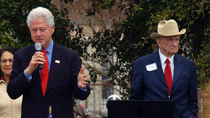 FILE - In this Feb. 20, 2008, file photo, former U.S. Rep. Jack Brooks, right, stands alongside former President Bill Clinton during a rally in downtown Beaumont, Texas. Brooks, a Democrat who spent 42 years representing his Southeast Texas district, has died at age 89. (AP Photo/Beaumont Enterprise, Guiseppe Barranco)