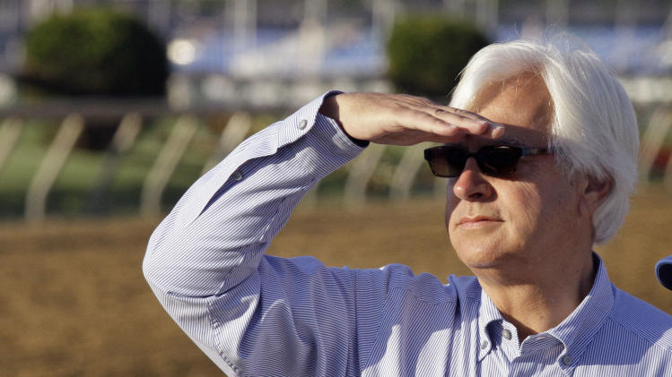 Hall of Fame trainer BobBaffert looks for his Preakness Stakes entrant Governor Charlie during a morning workout at Pimlico Race Course Friday, May 17, 2013 in Baltimore. The Preakness Stakes horse race is scheduled for Saturday. (AP Photo/Garry Jones)