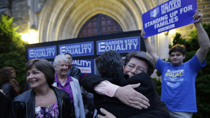 Cindy Meneghin, second from right, hugs her attorney Hayley Gorenberg during a rally at Garden State Equality in Montclair, N.J., hours after a Superior Court Judge ruled that New Jersey is unconstitutionally denying federal benefits to gay couples and must allow them to marry Friday, Sept. 27, 2013. Meneghin has been with her partner, Maureen Kilian, left, for 39 years. Judge Mary Jacobson ruled it legal for gay couples to marry in the state beginning Oct. 21, 2013. The ruling comes after a group of gay marriage supporters sued the state in July, days after the U.S. Supreme Court struck down key parts of a law that blocked the federal government from granting benefits to gay couples. (AP Photo/Julio Cortez)