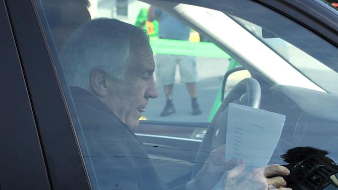 Former Penn State University assistant football coach Jerry Sandusky arrives for the fourth day his trial at the Centre County Courthouse in Bellefonte, Pa., Thursday, June 14, 2012.  Sandusky faces 52 counts of child sex-abuse  involving 10 boys over a 15-year span.  (AP Photo/Centre Daily Times, Nabil K. Mark)