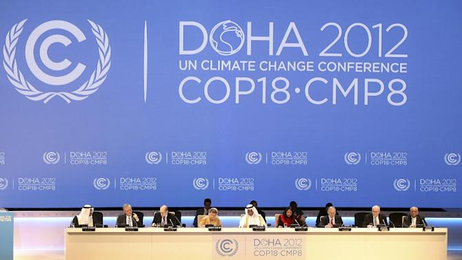 FILE - This Nov. 26, 2012 file photo shows organizers on stage at the opening ceremony of the 18th United Nations climate change conference in Doha, Qatar. The amount of heat-trapping pollution the world spewed rose again last year by 3 percent. So scientists say it's now unlikely global warming can be limited by more than a couple degrees, which is an international goal. (AP Photo/Osama Faisal, File)