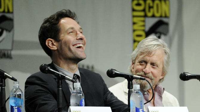 """Paul Rudd, left, and Michael Douglas, cast members in the upcoming Marvel film """"Ant-Man,"""" take part in the Marvel panel at Comic-Con International on Saturday, July 26, 2014 in San Diego, Calif. (Photo by Chris Pizzello/Invision/AP)"""
