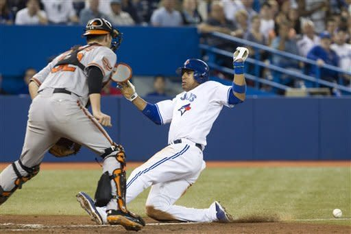 Davis drives in 3 runs to lead Jays over Orioles