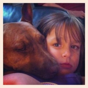 My pit bull mix Canine Belle and my daughter.