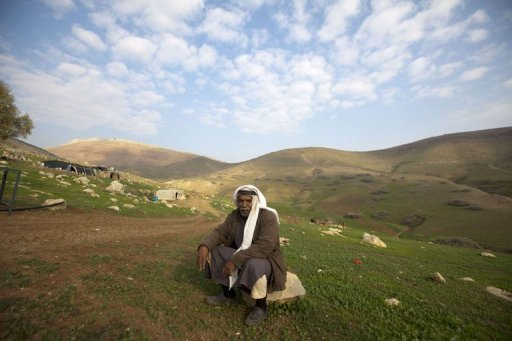 A Palestinian Bedouin man waits to evacuate on January 2, 2013, as the Israeli army readies to carry out military exercises in the Wadi al-Maleh area, in the West Bank's Jordan Valley