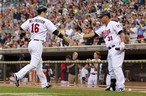 Morneau's single in 8th lifts Twins to win