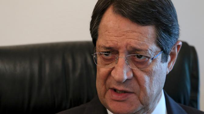Cypriot President Nicos Anastasiades speaks during a Reuters interview in Nicosia