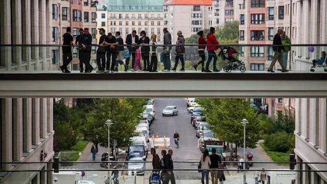 People stand on walkways at the LP12 Mall of Berlin on September 25, 2014