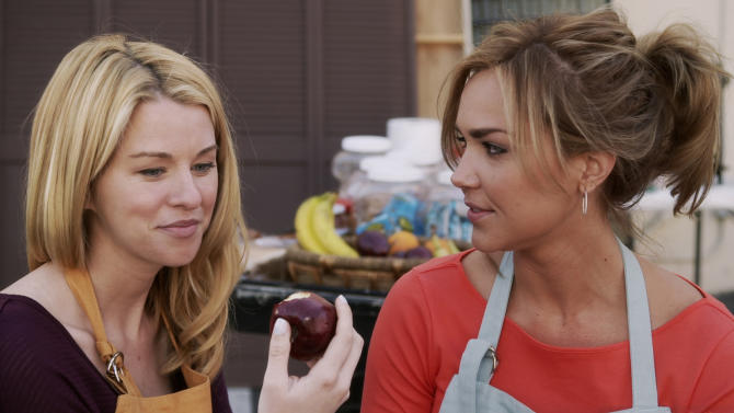 """In this undated publicity photo provided by WIGS, Kim Shaw as Audrey, left, and Arielle Kebbel as Marissa, are shown in a scene from """"Audrey."""" Directed by Betty Thomas, """"Audrey,"""" is a short Web series showing on the WIGS YouTube channel. (AP Photo/WIGS)"""