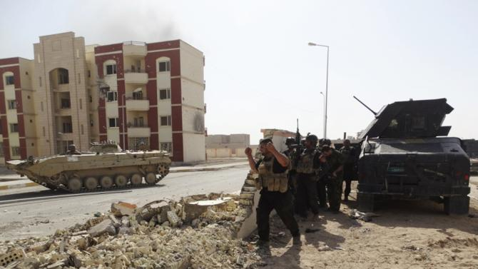 Members of Iraqi security forces patrol looking for Islamic State militants on the outskirts of Ramadi