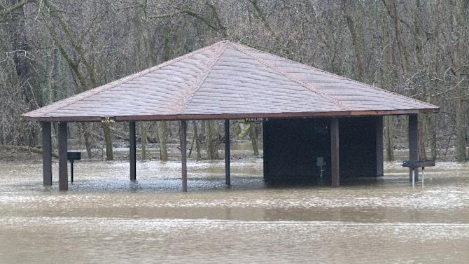 A pavilion at Imerman Memorial Park on Midland Road in Saginaw Township is flooded after the Tittabawassee River overflowed its banks on Thursday, April 11, 2013. Heavy rains over the past few days have saturated the ground. More rain is expected. (AP Photo/The Saginaw News, ) ALL LOCAL TV OUT; LOCAL TV INTERNET OUT