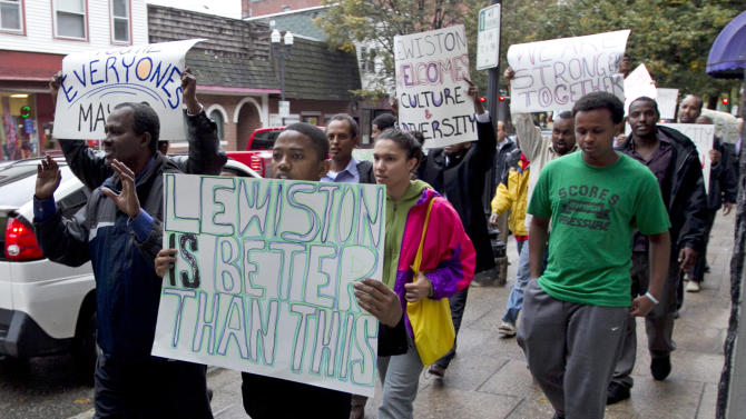 Protesters march in Lewiston, Maine, after delivering petitions asking for the resignation of the city's mayor because of comments he made about Somali refugees,Thursday, Oct. 4, 2012. (AP Photo/Robert F. Bukaty)
