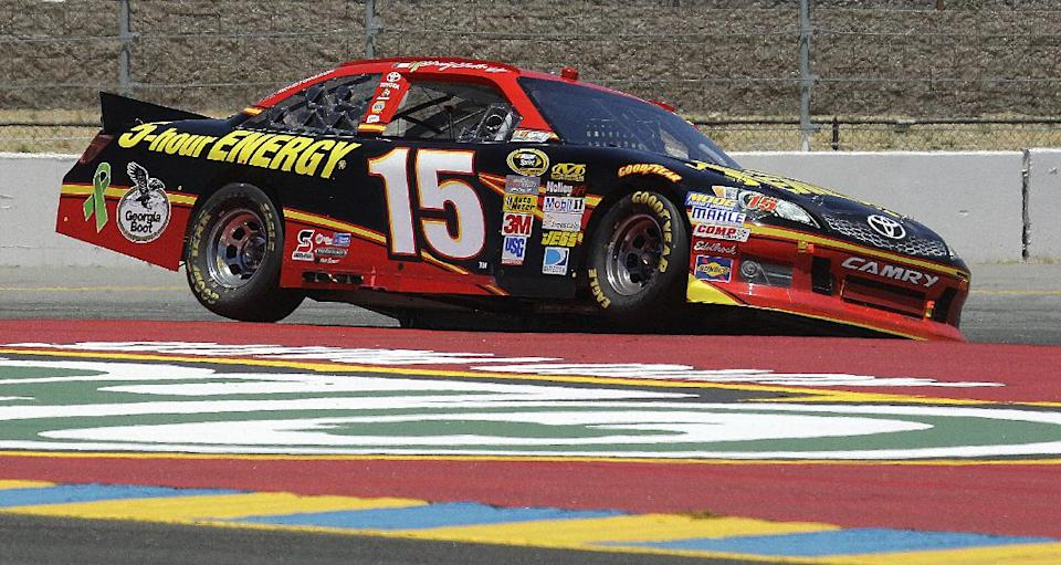 Clint Bowyer goes on two wheels as he rounds a corner during the NASCAR Sprint Cup Series auto race, Sunday, June 24, 2012, in Sonoma, Calif. (AP Photo/Ben Margot)