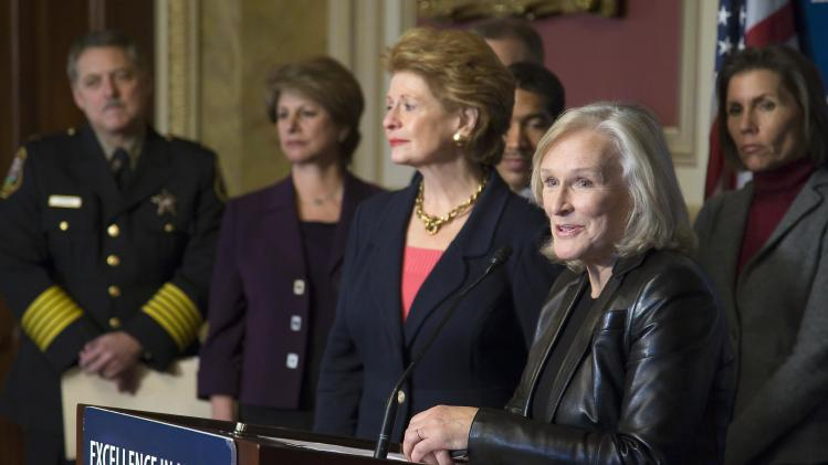 Actress Close and U.S. Senator Stabenow address a news conference at the U.S. Capitol in Washington